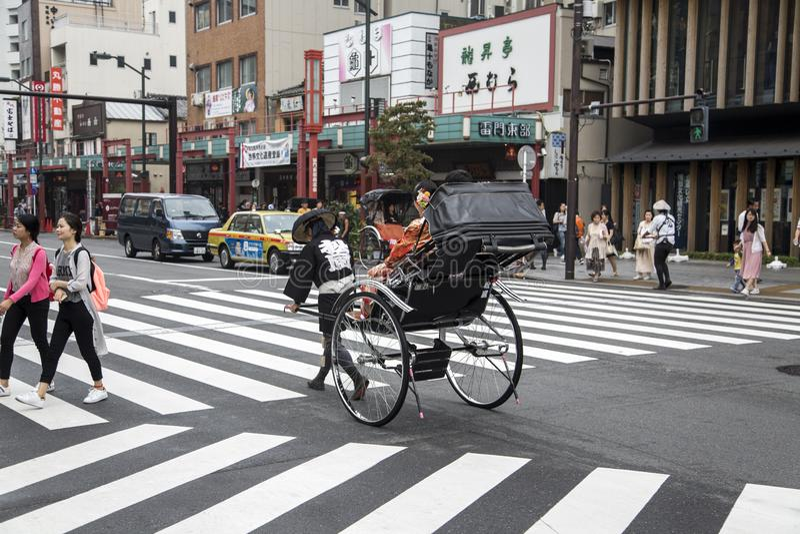 Езда рикши токио стоковое изображение