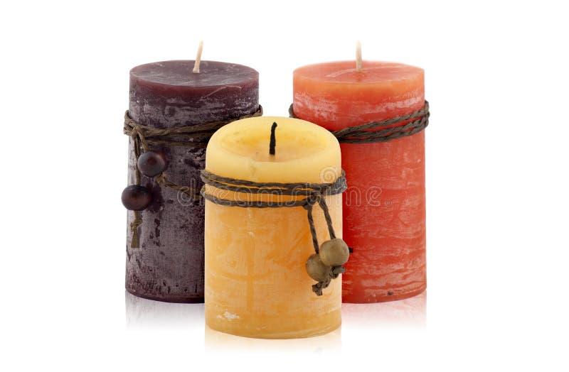 Download 3 декоративных свечи стоковое фото. изображение насчитывающей померанцово - 33730124