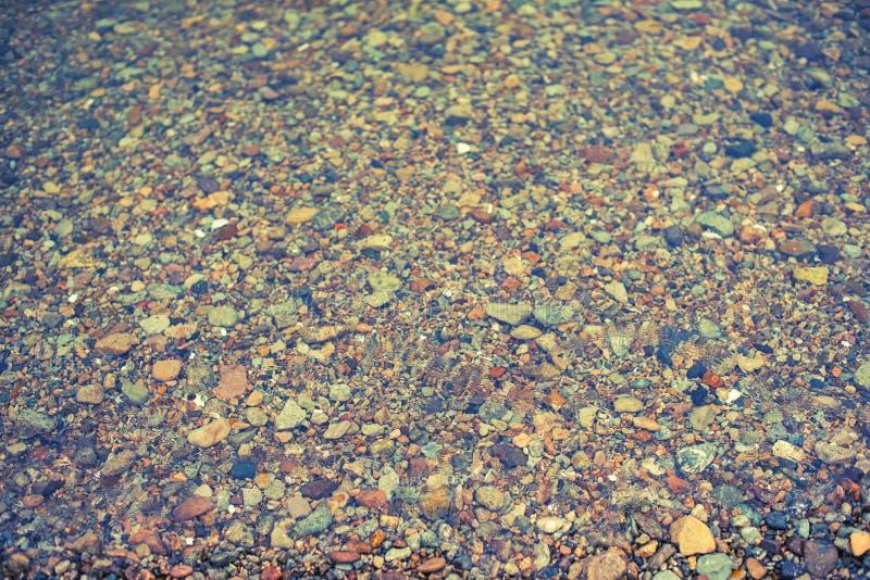 Естественная абстрактная предпосылка фона камешков моря декоративного текстурированного стоковые изображения