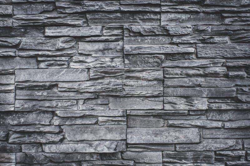 Естественная предпосылка каменной стены - серая текстура камня гранита стоковое изображение rf