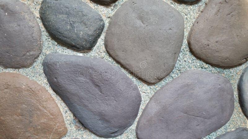 Естественная предпосылка обоев каменной стены стоковые изображения rf