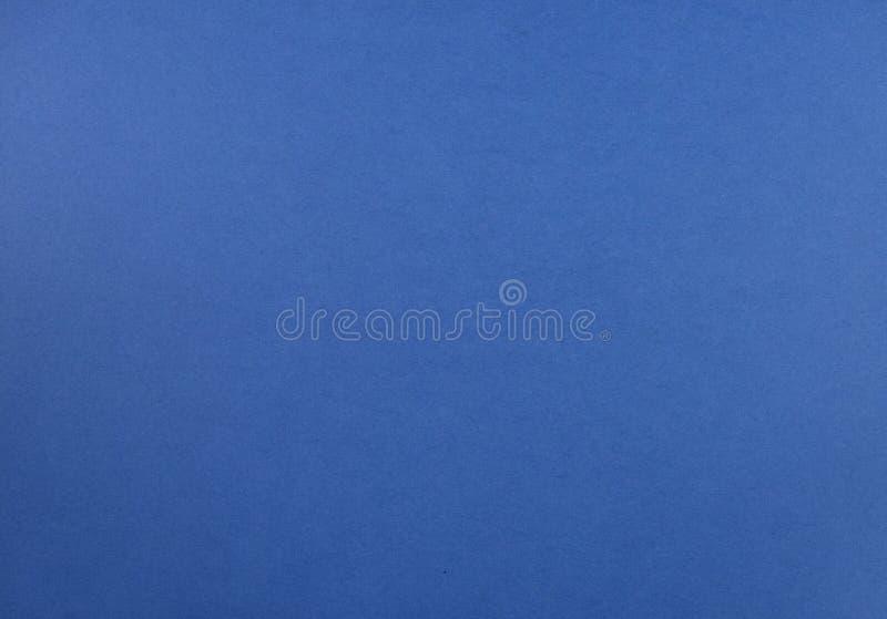 Естественная текстура покрашенной бумаги сини стоковые изображения