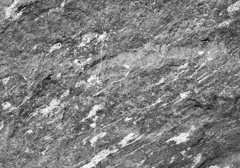 Естественное темное - текстура серого гранита каменная стоковая фотография