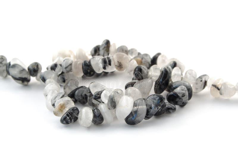 Естественные минеральные каменные волосы кварца с черной драгоценной камнем кристаллов турмалина стоковое изображение