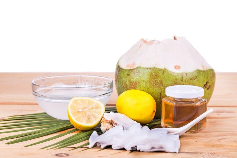 Естественный лицевой щиток гермошлема кокоса, лимона, меда для того чтобы moisturize кожа стоковое изображение rf