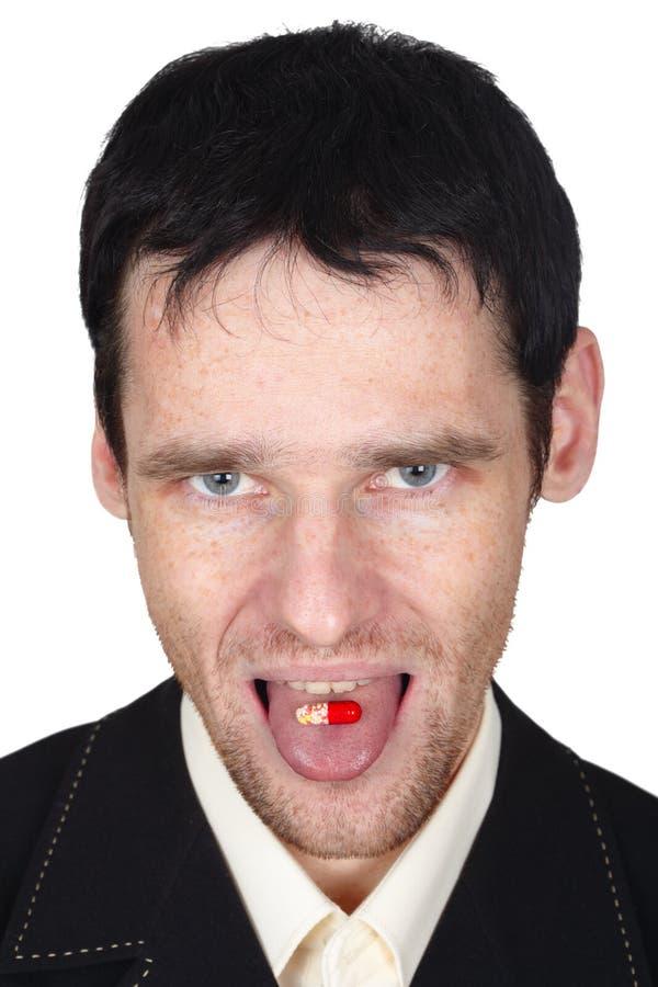 ест детенышей языка человека положенных пилюлькой стоковое фото rf