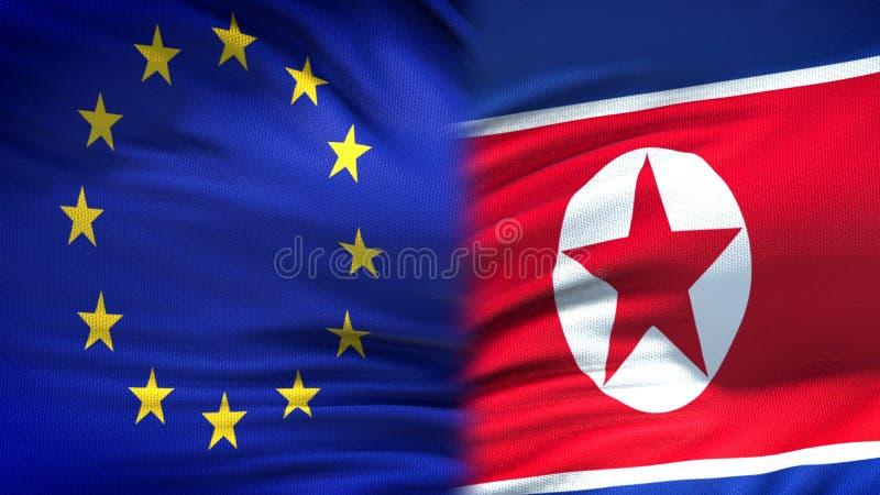 ЕС и предпосылка флагов Корейской Северной Кореи, дипломатический и экономические отношения стоковые фотографии rf