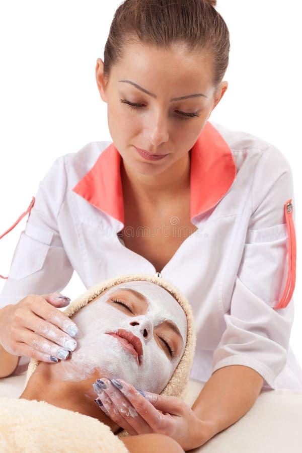 детеныши женщины маски глины лицевые стоковые фото