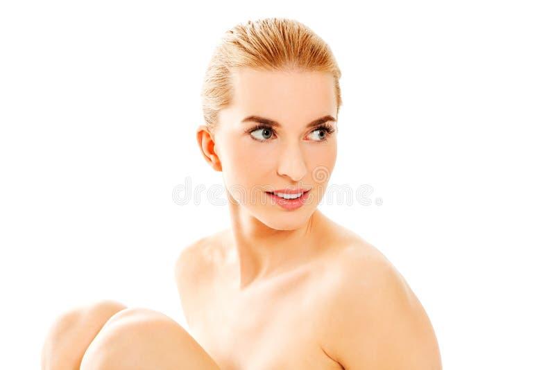 детеныши женщины обнажённого пола сидя стоковая фотография rf