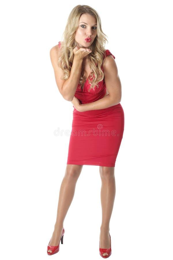 детеныши женщины платья красные нося стоковые изображения rf