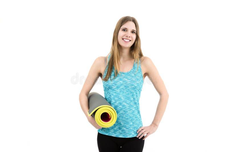 детеныши женщины стены пригодности предпосылки серые стоковое изображение