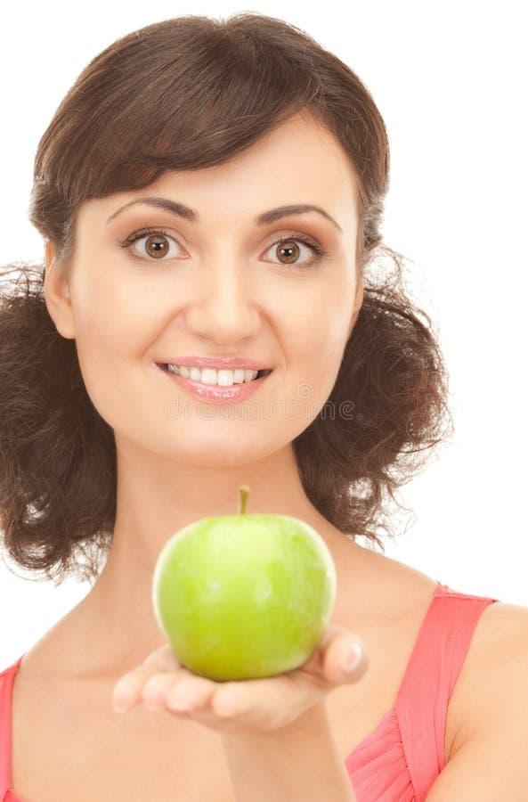 детеныши женщины яблока красивейшие зеленые стоковое изображение