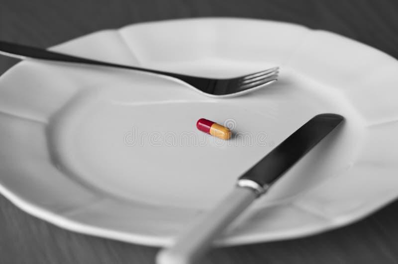 Еда в пилюльке стоковое изображение