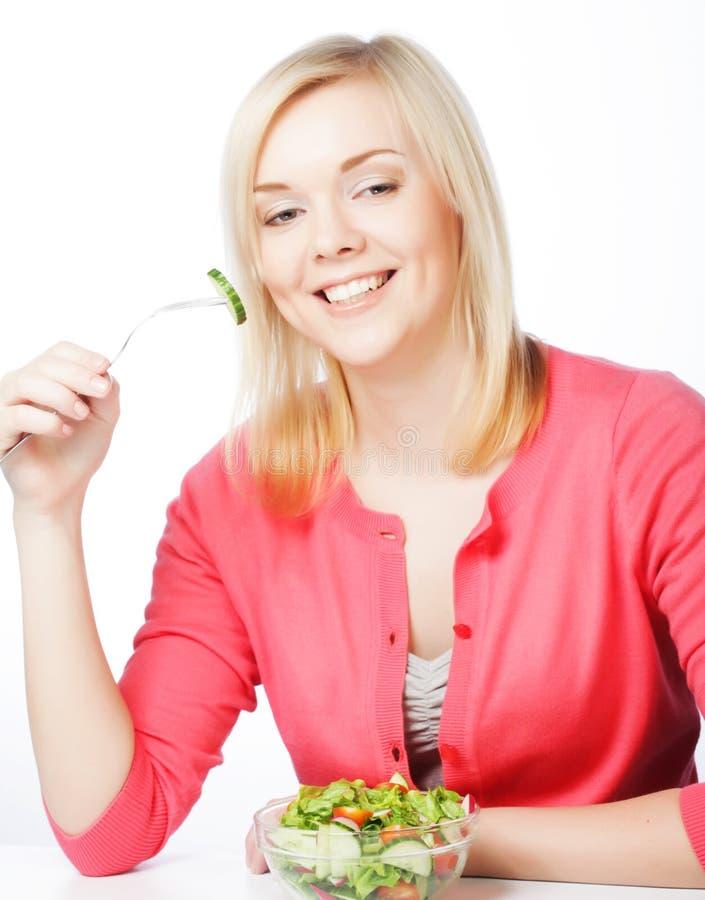 ел девушку еды здоровую стоковые изображения