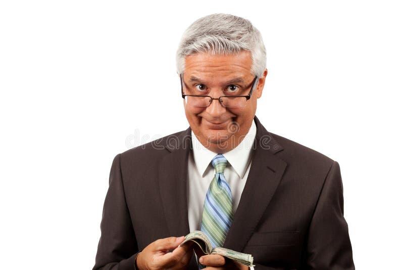 Жадный бизнесмен стоковая фотография