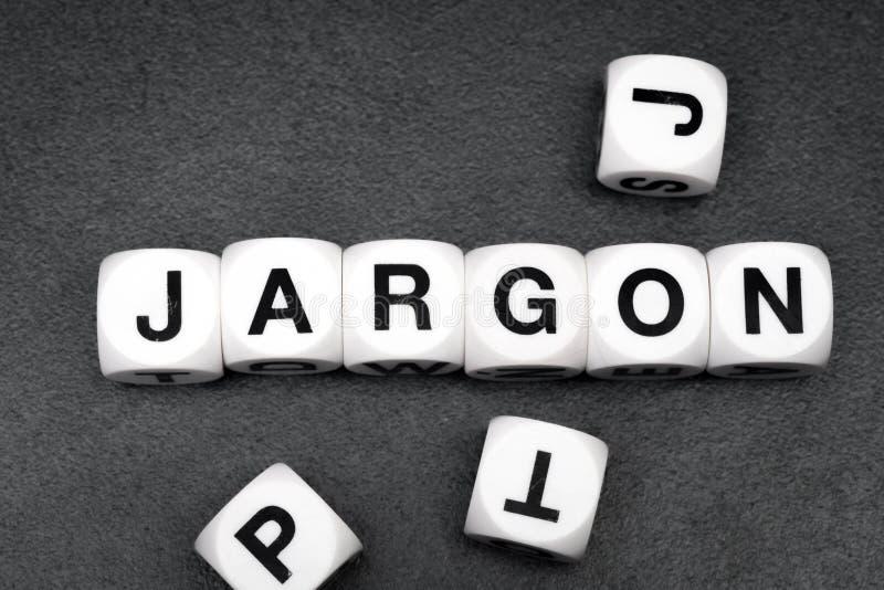 Жаргон слова на кубах игрушки стоковые изображения