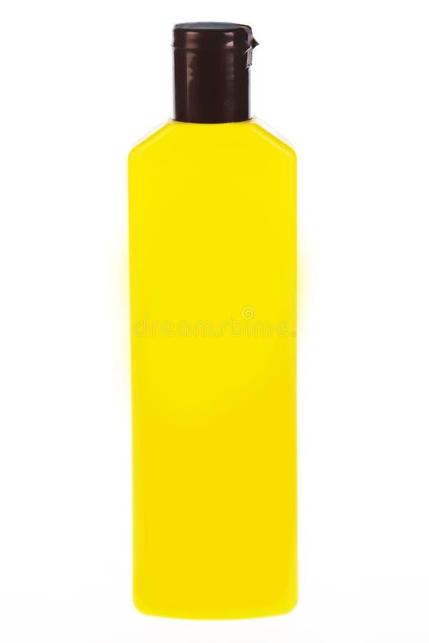 Желтая бутылка трубки шампуня, проводника, rinse волос, геля, на белой предпосылке с отражением стоковые фото