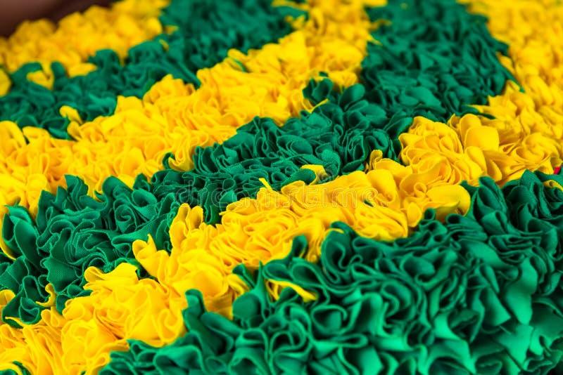 Желтая и зеленая текстура ковра, предпосылка стоковое фото rf