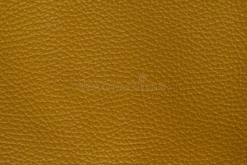 Желтая кожаная предпосылка текстуры стоковые фото
