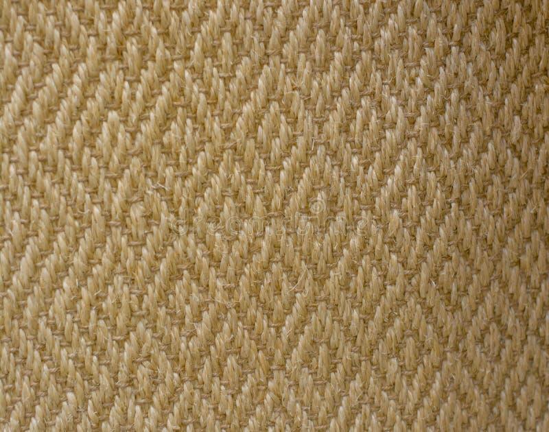 Желтая текстура стены ковра циновки соломы стоковое фото