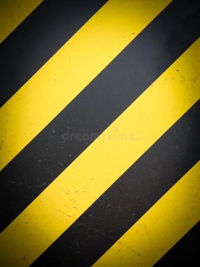 Желтая черная striped предпосылка предупреждения опасности стоковые фото