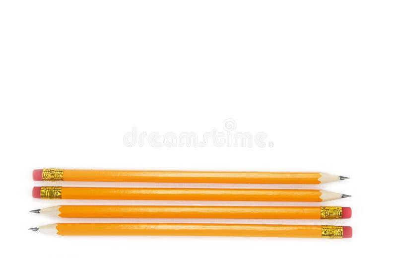 Желтые карандаши с ластиком на белой предпосылке, стоковая фотография rf
