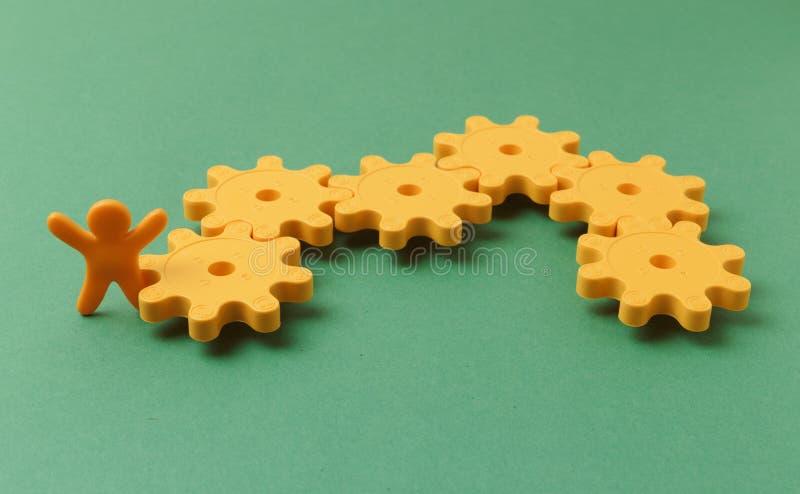 желтые пластиковые шестерни стоковое изображение