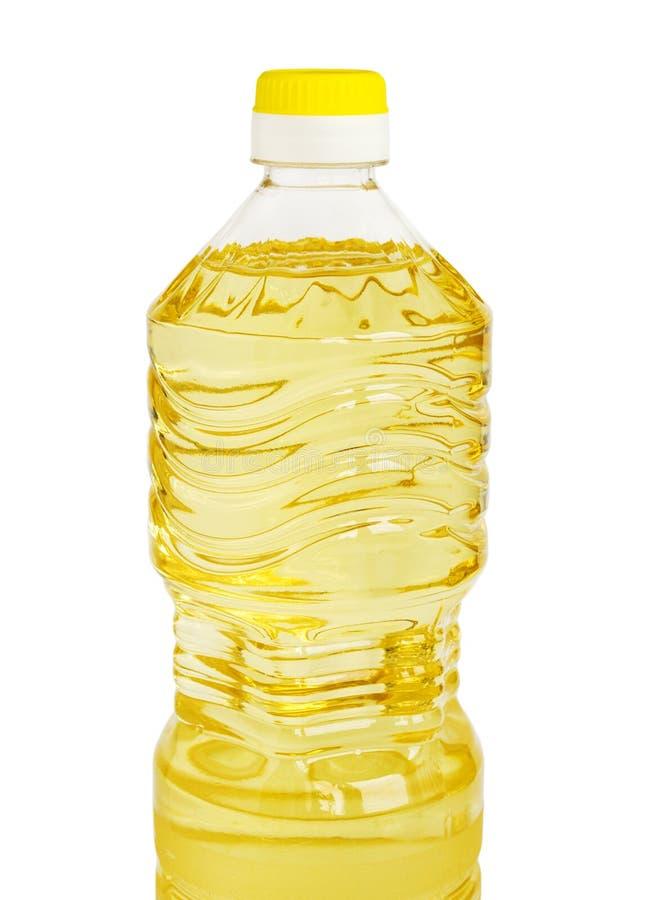 Желтые солнцецвет или постное масло в пластиковой бутылке литра изолированной на белой предпосылке стоковые изображения rf