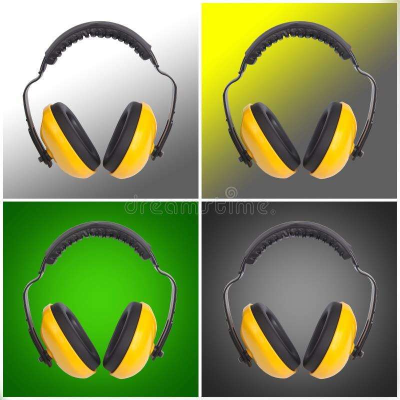 Желтые earmuffs защиты стоковое изображение