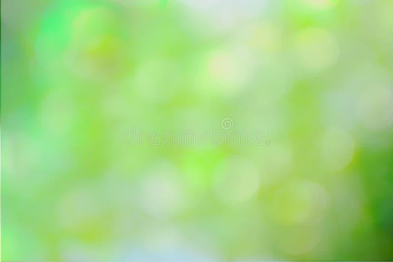 желтый цвет абстрактной предпосылки defocused зеленый стоковые изображения