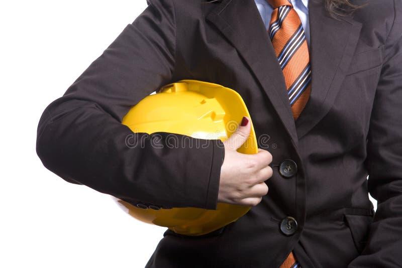 желтый цвет женщины безопасности шлема стоковые изображения