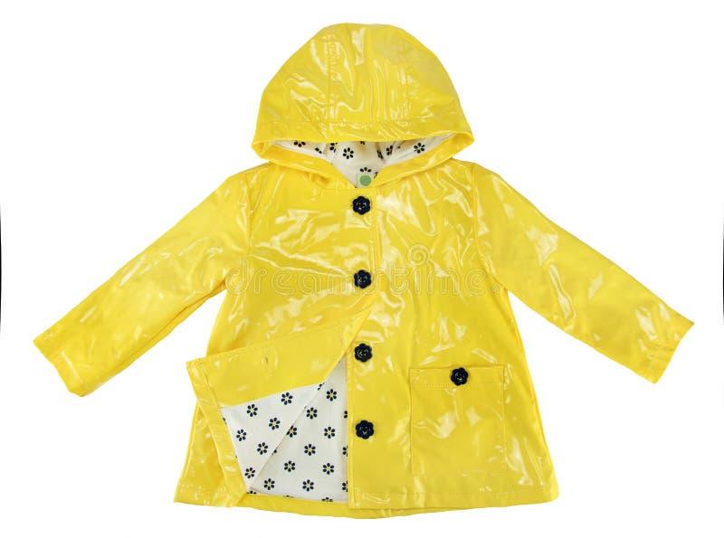 Желтый цвет куртки дождя элегантности для девушки стоковые изображения