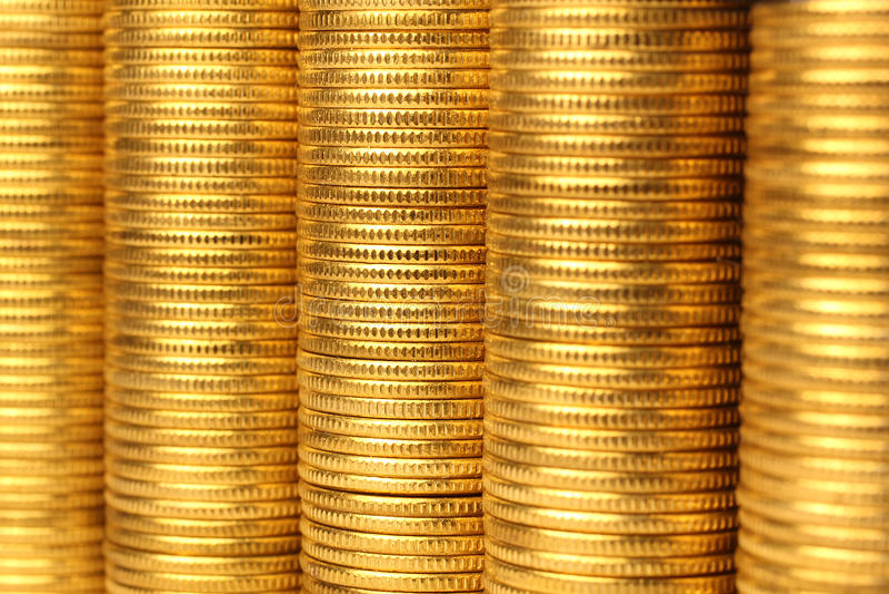 желтый цвет металла монеток стоковая фотография
