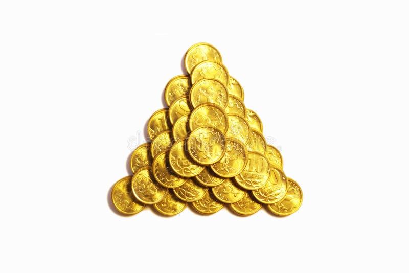 желтый цвет пирамидки металла монеток триангулярный стоковое фото