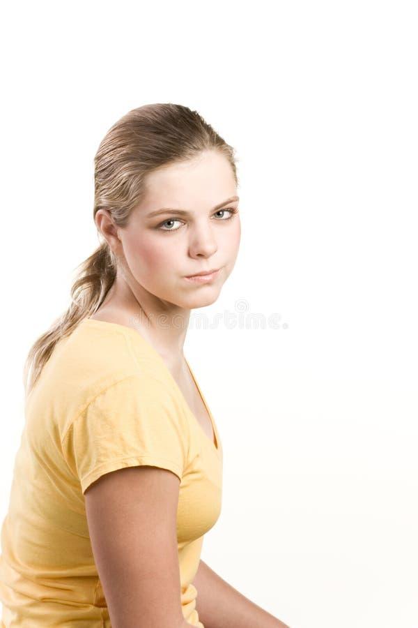 желтый цвет портрета headshot девушки кофточки подростковый стоковое фото