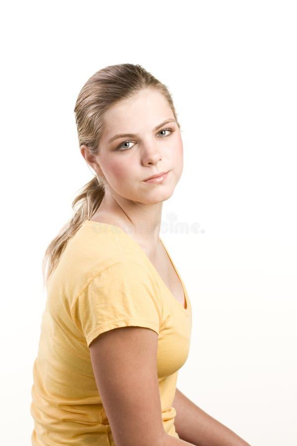 желтый цвет портрета headshot девушки кофточки подростковый стоковые изображения