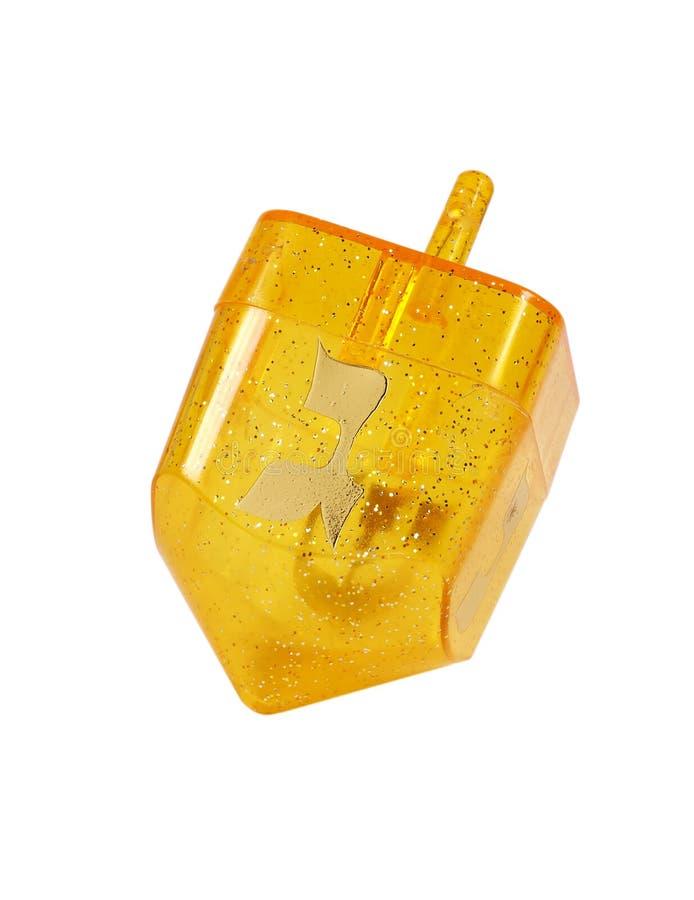 желтый цвет dreidel стоковая фотография