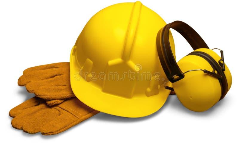 Желтый шлем безопасности с перчатками и ухом безопасности стоковые фото
