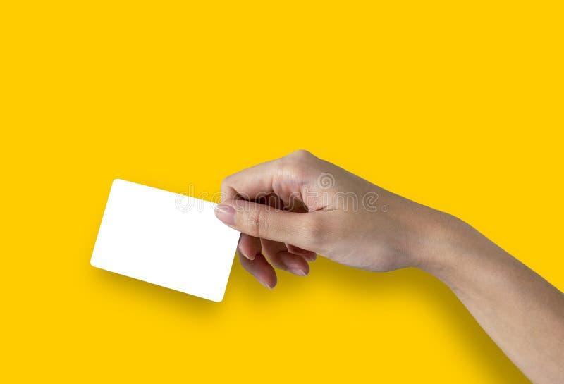 Женская карточка или кредитная карточка с жёлтым фоном стоковые изображения rf