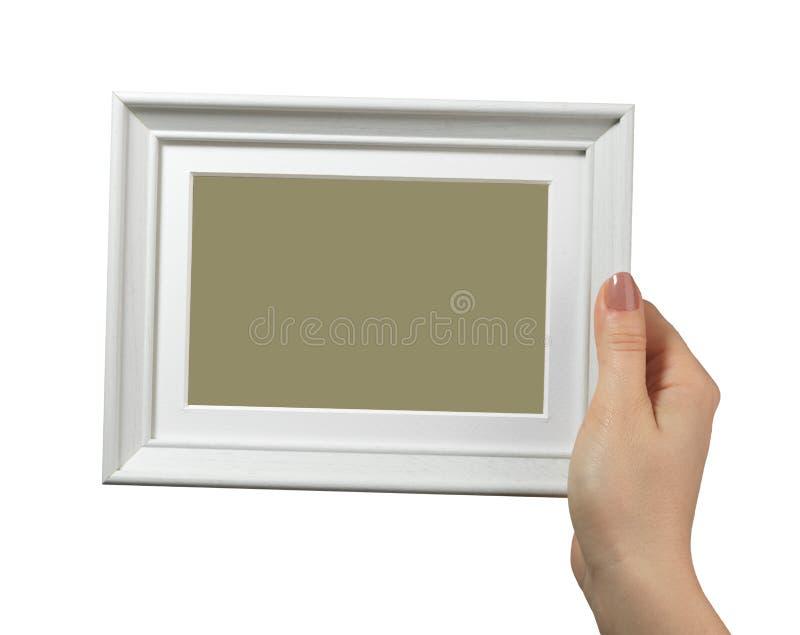 Женская рука держа деревянную рамку изолированный на белой предпосылке стоковая фотография rf