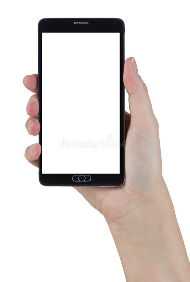 Женская рука держа умный телефон с пустым экраном на белизне стоковое фото