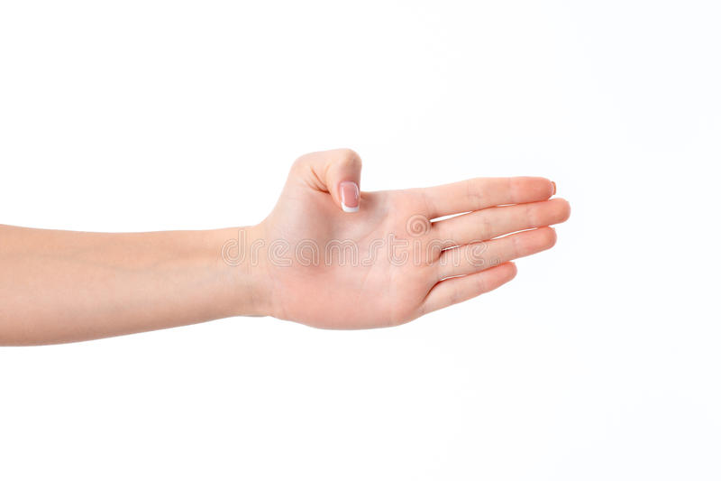 Женская рука протягиванная к стороне и показывать ладонь вашего изолированную на белой предпосылке стоковые фото