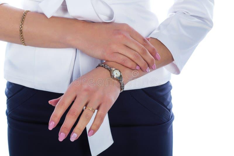 Женская рука с часами стоковые фото