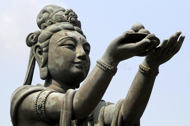Женская статуя ученика на большом Будде, острове Lantau, Гонконге стоковое фото