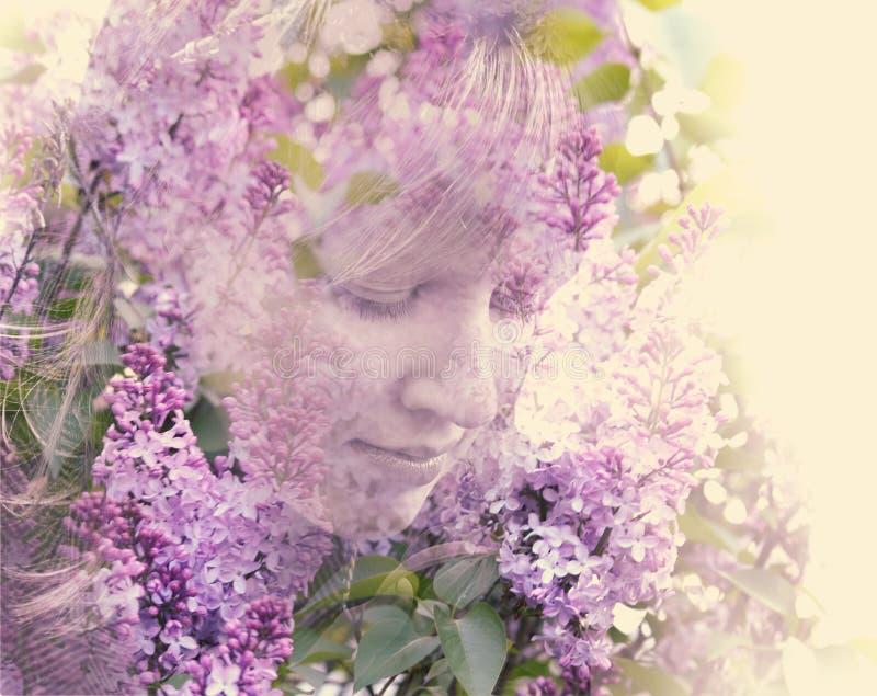 Женская сторона показанная в цветах сирени стоковое фото rf