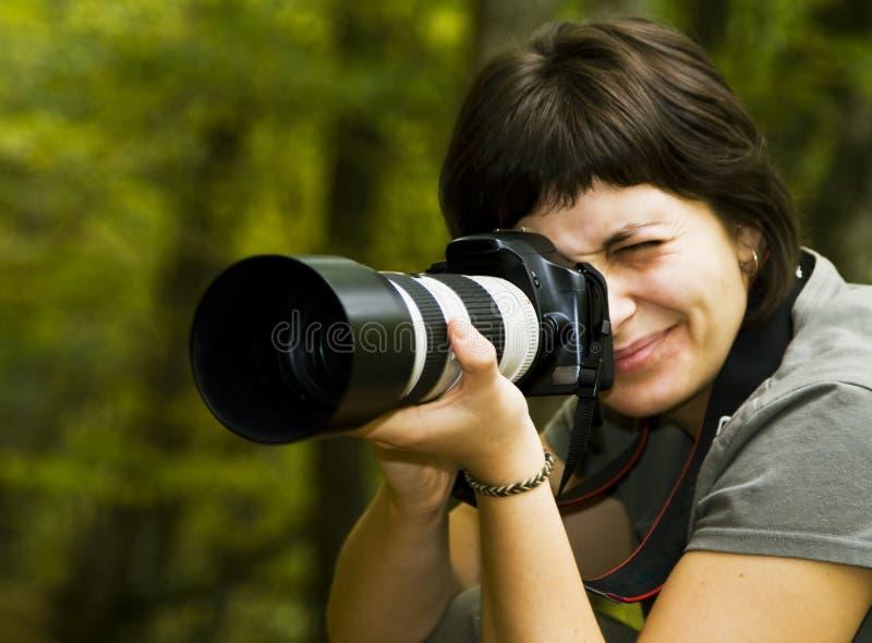 женские детеныши фотографа стоковые фотографии rf