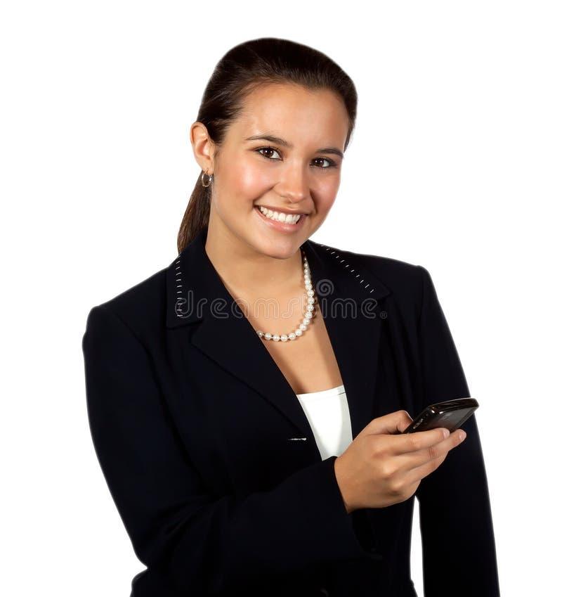 женский испанский мобильный телефон используя yougn стоковая фотография rf