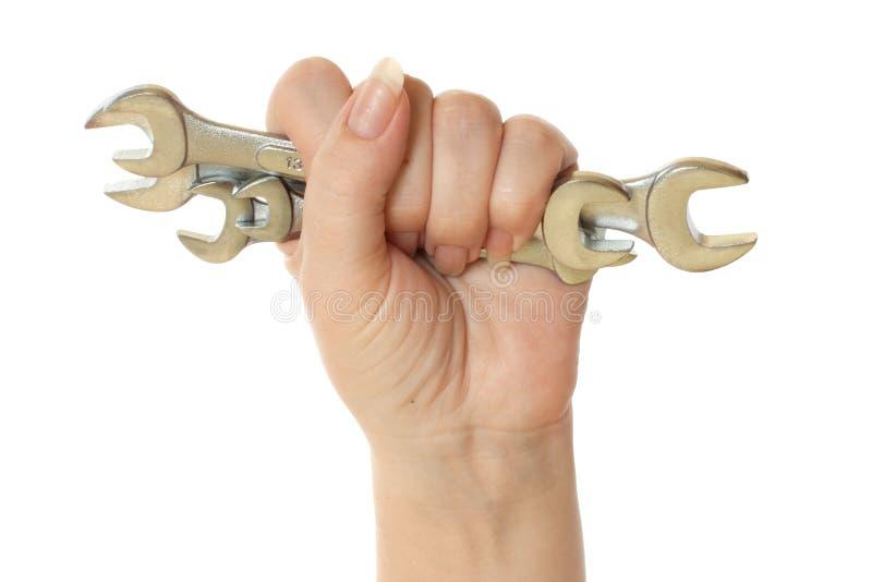 женский ключ инструментов удерживания руки стоковые фото