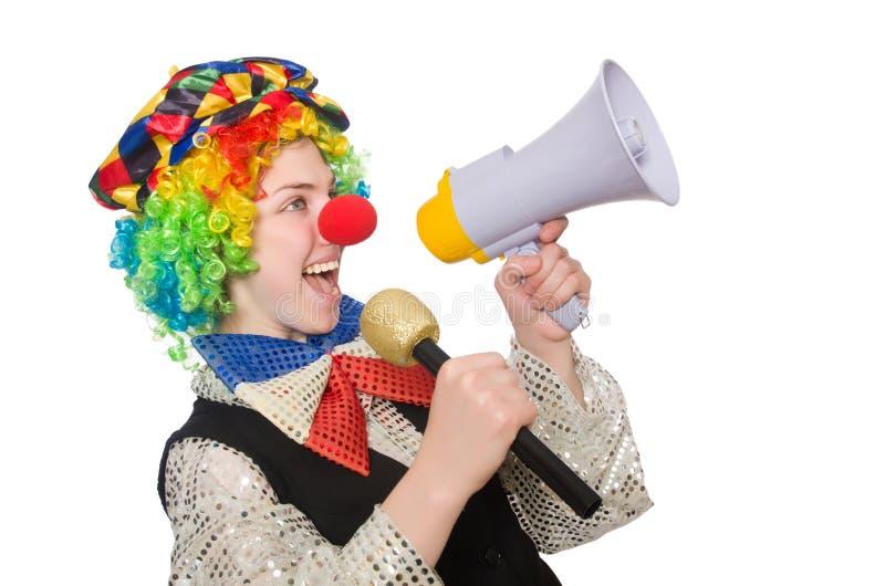 Женский клоун держа мегафон изолированный на белизне стоковые изображения rf