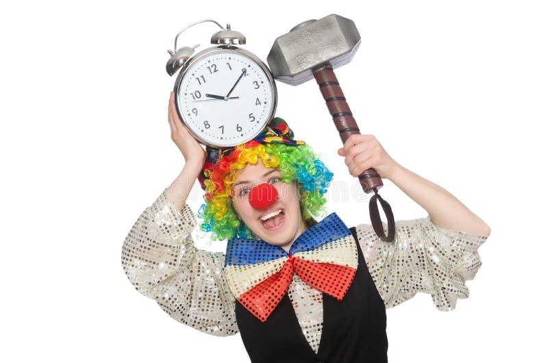 Женский клоун при изолированные будильник и молоток стоковые фото